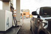 Car fueling on gas station, fuel refill, nobody poster