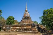 Ancient Stupa Of The Buddhist Temple Wat Chedi Ngarm On A Sunny Day. The Surroundings Of Sukhothai.  poster