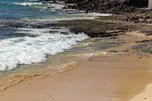 View At The Beach And Coastline In Morro Jable On Canary Island Fuerteventura With Rough Sea, Water  poster