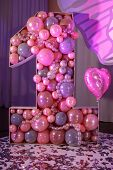 Big Number One Of The Pink Color Baloons For Childrens Birthday. A Light, Pink And Purple Interior D poster