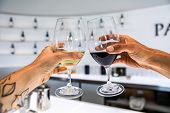 White And Red Wine Glasses Cheering Selective Focus Against White Interior Design Bar Counter Of A B poster