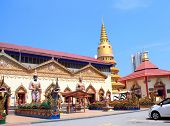 Statues of kinnaris, dragons and snakes-nagas Pavilion in Pulau Tikus, thai Buddhist temple Wat Chay poster