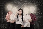 stock photo of electricity  - Business manager and team with light bulb heads - JPG