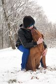 picture of emo-boy  - Funky boy is having fun with his dog in the snow - JPG