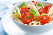 stock photo of black-cherry  - Pasta salad with penne cherry tomatoes and basil - JPG