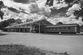 picture of caboose  - A high contrast and textured vintage representation of an old South Carolina train depot - JPG