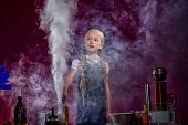 foto of reagent  - Charmed little girl in cloud of steam from evaporation of reagent - JPG