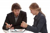 foto of negotiating  - Hard negotiations between two financial specialists working for banks - JPG