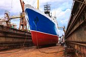 stock photo of shipyard  - Cargo ship is being renovated in shipyard Gdansk Poland - JPG
