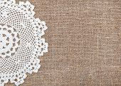 stock photo of rude  - Burlap textile background and white lacy cloth - JPG