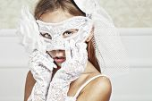 picture of incognito  - Portrait of a fashion girl wearing wedding dress and venetian mask - JPG
