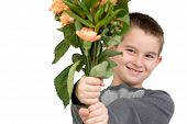 stock photo of saying sorry  - Eight years old boy presenting flowers perhaps he is trying to say sorry or its Mothers Day - JPG
