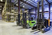 image of picking tray  - Three forklift in the large modern a warehouse - JPG
