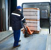 picture of lift truck  - Worker loading truck on the forklift in the trailer truck - JPG