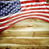 Closeup of American flag on wooden background