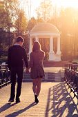 picture of jeans skirt  - Young fashion elegant stylish couple posing in a European city park at dawn - JPG