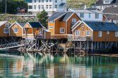 image of reining  - Typical Norwegian fishing village with traditional red rorbu huts Reine Lofoten Islands Norway - JPG