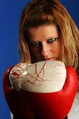 stock photo of pissed off  - Girl with boxing gloves - JPG