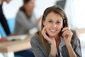 pic of telemarketing  - Smiling customer service representative at work - JPG