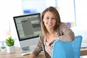 pic of cheers  - Cheerful business girl in front of desktop computer - JPG