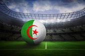 stock photo of algeria  - Football in algeria colours in large football stadium with lights - JPG
