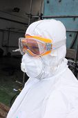 foto of ppe  - an industrial employee in full personal protection equipment - JPG