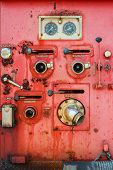 picture of vacuum pump  - Old fire truck equipment with fading color - JPG