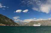 foto of passenger ship  - Large passenger ship leaves the Bay of Kotor Montenegro - JPG
