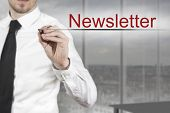 picture of newsletter  - businessman in office writing newsletter in the air - JPG
