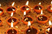 stock photo of diwali lamp  - oil lamps lit beautifully in diwali festival - JPG