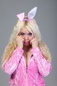 stock photo of bunny costume  - Beautiful young blond woman as easter bunny with rabbit ears on  - JPG