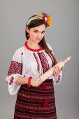 stock photo of domina  - Housewife with rolling pin - JPG