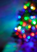 stock photo of fir  - Shiny blur bokeh background with Christmas multicolored lights fir tree - JPG