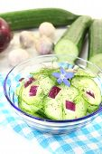 foto of borage  - Cucumber salad with onions dill and borage flower on a light background - JPG