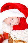 pic of new years baby  - Cute newborn baby wearing Santa Claus hat sleeping in basket - JPG