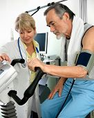 stock photo of ekg  - Patient is being observed by doctor  - JPG