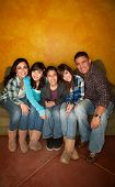 foto of mother child  - Attractive Hispanic Family Sitting on a Green Couch - JPG