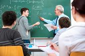 pic of tutor  - Teacher with a group of high school students in classroom - JPG