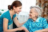 foto of granddaughters  - Senior woman with her caregiver at home - JPG