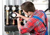 stock photo of boiler  - Technician servicing the gas boiler for hot water and heating - JPG