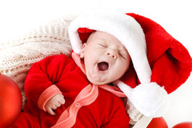 stock photo of new years baby  - Cute newborn baby wearing Santa Claus hat sleeping in basket - JPG