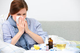 stock photo of high fever  - Sick woman  lying in bed with high fever - JPG