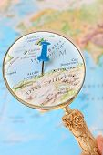 stock photo of algiers  - Blue tack on map of Africa with magnifying glass looking in on Algiers Algeria - JPG