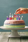 stock photo of pinata  - Series on Pinata Cake a celebration cake with a hidden stash of sweets inside - JPG