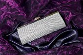 foto of clutch  - clutch with pearls on a silk background - JPG