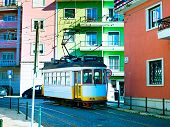 pic of tram  - Retro style tram on the street of Lisbon downtown - JPG