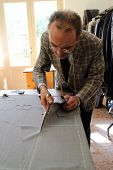 stock photo of tailoring  - Real tailor in a small town near Assisi in Italy - JPG