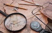picture of cartographer  - Historian cartographer table upper view with old damaged map - JPG