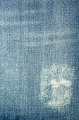 pic of rip  - Ripped blue jeans closeup texture and background - JPG