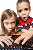foto of fanny  - Children surprise and emotional look at the laptop screen - JPG